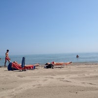 Photo taken at Spiaggia (Isola Verde) by Fabio D. on 8/9/2014