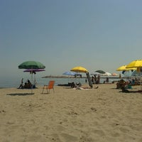 Photo taken at Spiaggia (Isola Verde) by Fabio D. on 7/19/2014