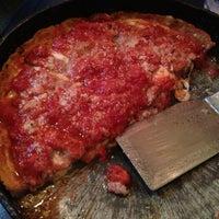 Photo taken at Lou Malnati's Pizzeria by James W. on 12/23/2012