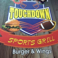 Photo taken at Touchdown Burger & Wings by Mauricio B. on 12/26/2013