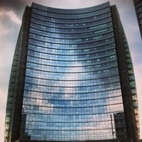 Photo taken at Unicredit Tower by Cyril R. on 7/20/2013