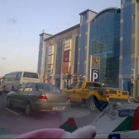Photo taken at Ansar Mall by Lily F. on 12/26/2012