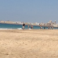 Photo taken at La Victoria Beach by Susana B. on 5/4/2013