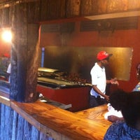 Photo taken at Scotchies Jerk Centre by Quincy T. on 5/15/2013