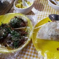 Photo taken at Tacos Los Primos by Mariela R. on 2/25/2016