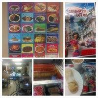 Foto tomada en Cubabana's Cafe por Chris R. el 7/1/2014