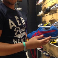 Photo taken at Onitsuka Tiger by Mishelle A. on 12/29/2013