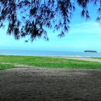 Photo taken at Pantai Cermin by Dave F. on 6/28/2014