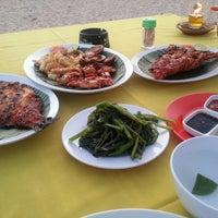 Photo taken at Kampung seafood Jimbaran by Ji young P. on 3/22/2013