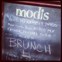 Photo taken at Modis by Joel C. on 8/18/2013