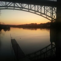 Photo taken at Calhoun's on the River by Bryan M. on 3/14/2013