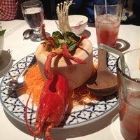 Photo taken at Mengrai Gourmet Thai by Cindy L. on 1/3/2014