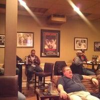 Photo taken at Fume Cigar Shop & Lounge by Carlton Y. on 12/9/2012