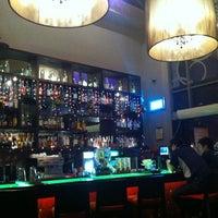 Photo taken at Michelangelo's Restaurant & Bar by Miimo L. on 12/24/2012