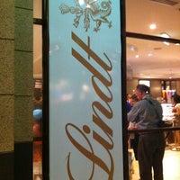 Photo taken at Lindt Chocolat Café by Kay W. on 12/29/2012