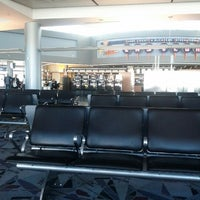 Photo taken at Concourse D by Tanisha R. on 10/23/2012