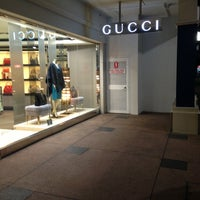 Photo taken at Gucci by Princess A. on 8/5/2013