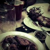 Photo taken at Iwak'e Seafood by GunX M. on 10/1/2012