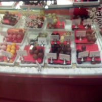 Photo taken at Godiva Chocolatier by Sonya B. on 12/9/2012