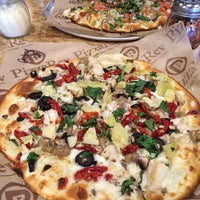 Photo taken at PizzaRev by Jonathan A. on 6/6/2014
