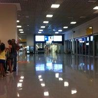 Photo taken at Terminal 1 (TPS1) by Flávio P. on 12/29/2012