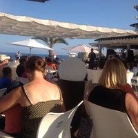 Photo taken at Chiringuito playa Varadero by Juan Carlos R. on 8/3/2014