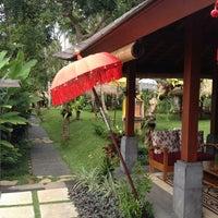 Photo taken at Ubud Padi Villa by Mark S. on 7/7/2013