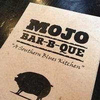 Photo taken at MOJO Bar B Que, A Southern Blues Kitchen by Lauren R. on 12/20/2012