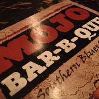 Photo taken at MOJO Bar B Que, A Southern Blues Kitchen by Lauren R. on 11/1/2012