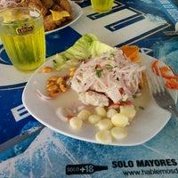 Photo taken at Playa León Dormido by Cynthia R. on 2/21/2015