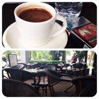 Photo taken at Starbucks by Melih E. on 5/7/2014