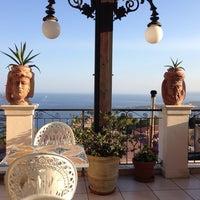 Photo taken at Taodomus Hotel Taormina by Fırat E. on 8/15/2014