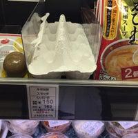Photo taken at 明治屋 六本木ストアー by Hidehiro N. on 3/26/2015