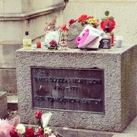 Photo taken at Tombe de Jim Morrison by Stefan V. on 5/26/2013