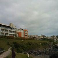Photo taken at Costão da Praia do Santinho by André d. on 12/19/2012