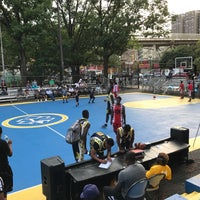 Photo taken at Rucker Park Basketball Courts by NYC H. on 8/10/2017