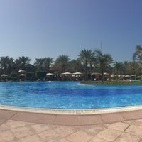 Photo taken at Emirates Palace Hotel Swimming Pool by Clythie C. on 11/2/2015