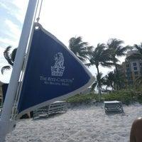 Photo taken at Ritz Carlton Key Biscayne white sand beach by Tim M. on 4/16/2016