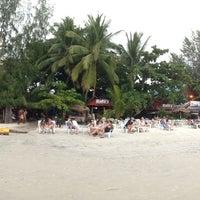 Photo taken at Pantai Cenang (Beach) by Gvozd A. on 6/15/2013