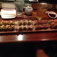 Photo taken at The Flying Fish Café & Sushi Bar by Laura F. on 7/4/2014