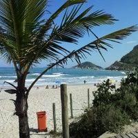 Photo taken at Praia de Grumari by Marcelo d. on 10/9/2012