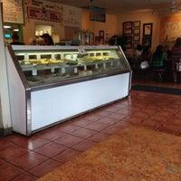Photo taken at Cafe 1217 by Lisa B. on 8/8/2014