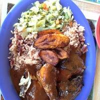 Photo taken at Island Spice Jamaican Restaurant by Tara I. on 7/28/2013