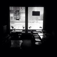 Photo taken at White Dog Black Cat Cafe by Amanda G. on 11/9/2013
