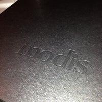 Photo taken at Modis by Seth H. on 12/14/2012