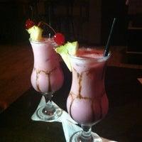 Photo taken at Rosário Resto Lounge Pub by Vanessa V. on 12/4/2012