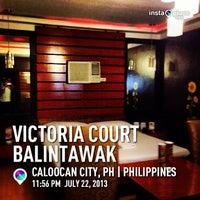Photo taken at Victoria Court Balintawak by Omar P. on 7/22/2013
