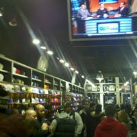Photo taken at New Era Flagship Store: New York by Kimberly W. on 11/16/2012