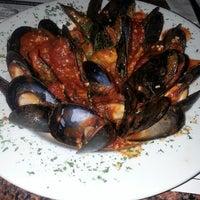 Photo taken at Chuck's Alibi Pub & Seafood House by Vikki on 3/31/2013