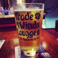 Photo taken at Tradewinds Tropical Lounge by Eric K. on 4/11/2014
